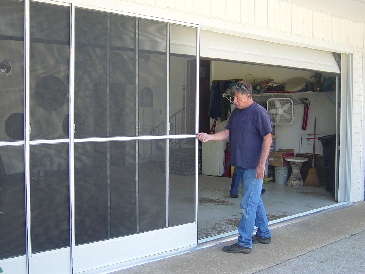 Garage Sliding Screen Door Rollerssliding garage door screens from killians of palm coast fl