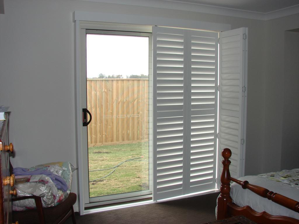 Plantation Shutters Over Sliding Glass Door