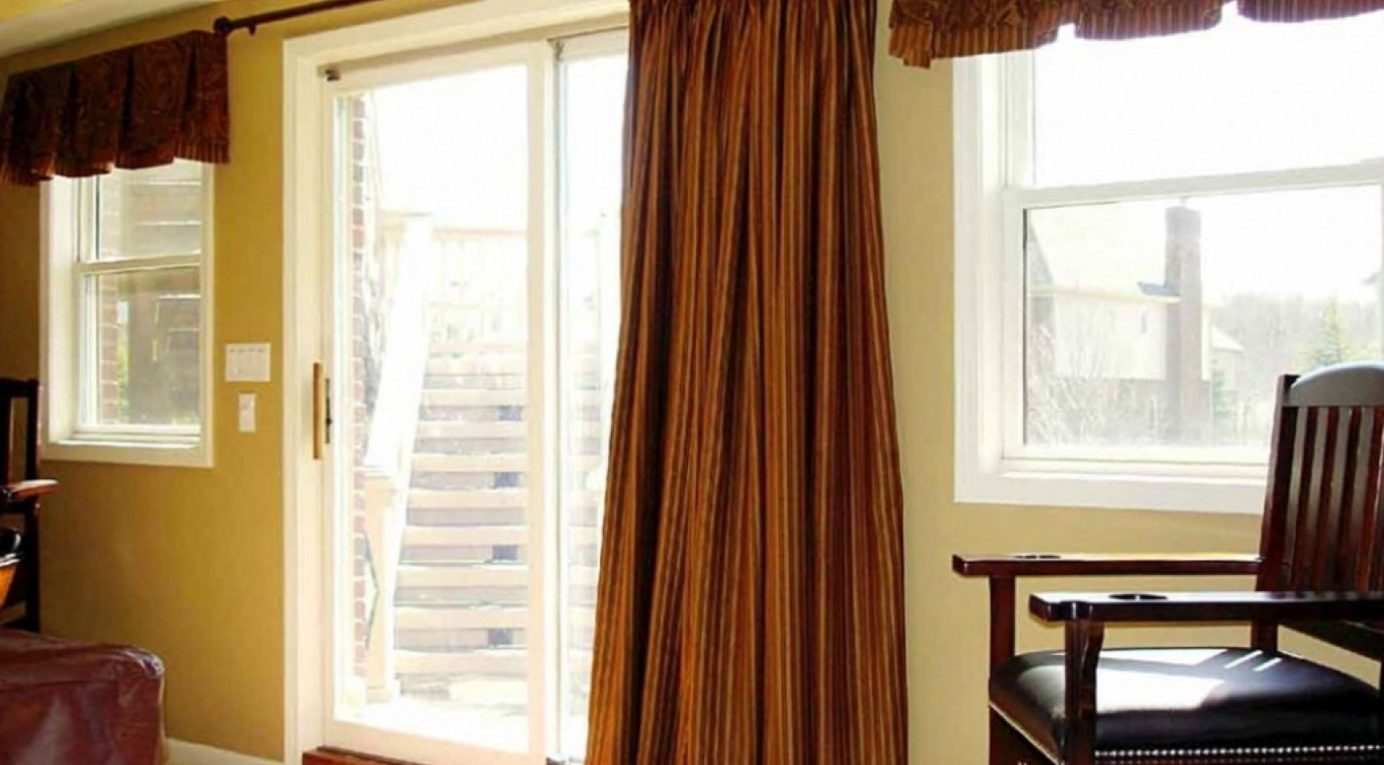 How to hide curtain rod center support curtain for Center sliding patio doors